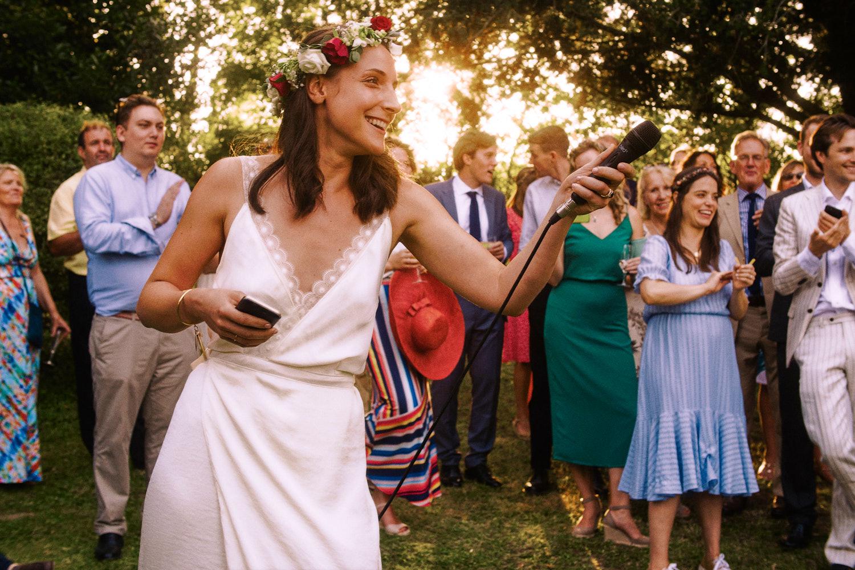 Bride gives outdoor speech during garden reception