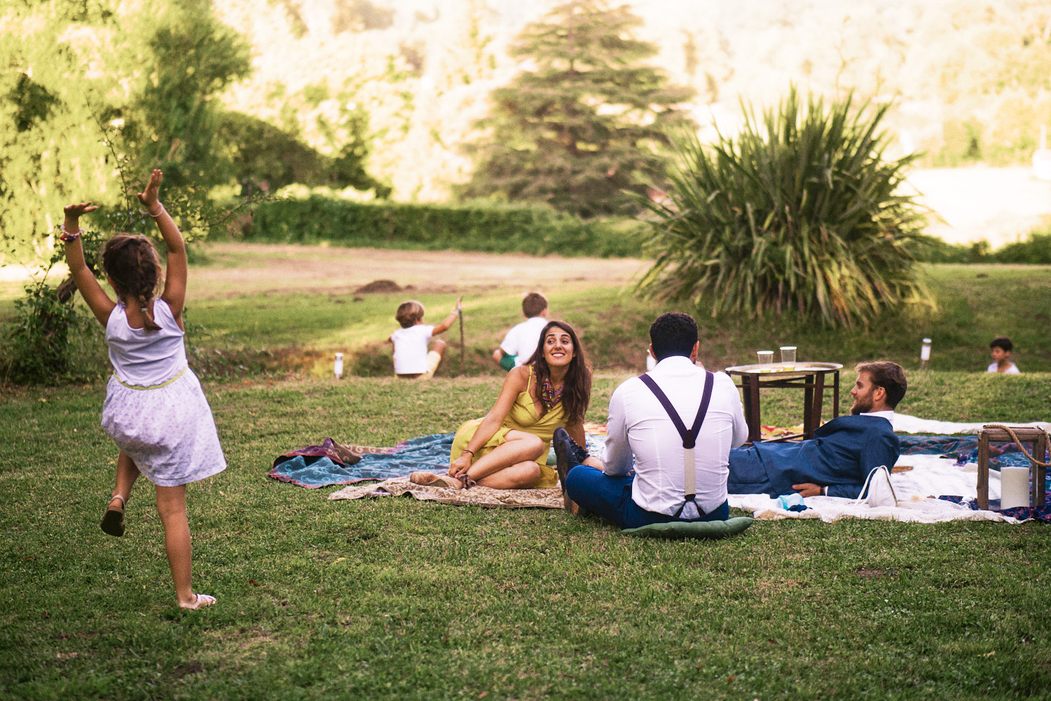 Wedding guests enjoy picnic in France