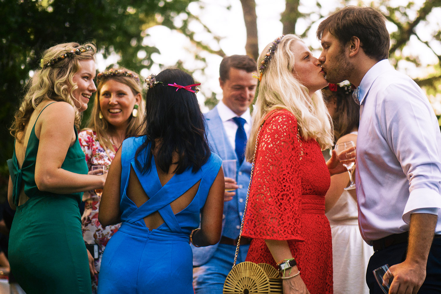 A couple kiss during an outdoor wedding reception in France