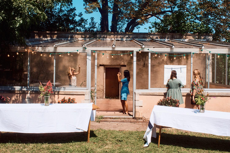 Bridesmaids decorating garden for wedding reception