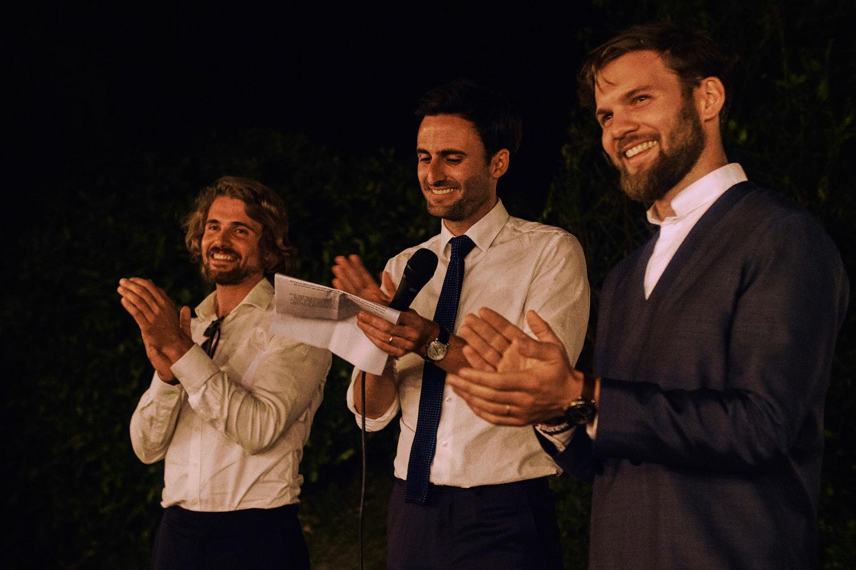 Threee wedding speakers applaud the bride