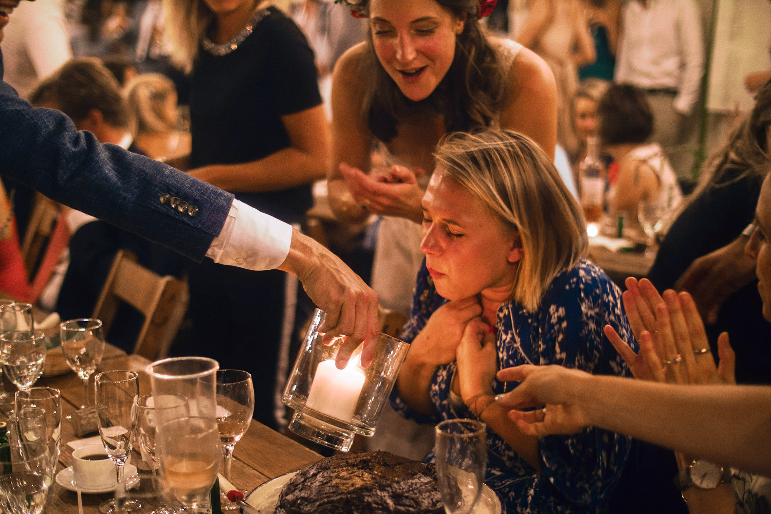A wedding guests blows out candles on her birthday