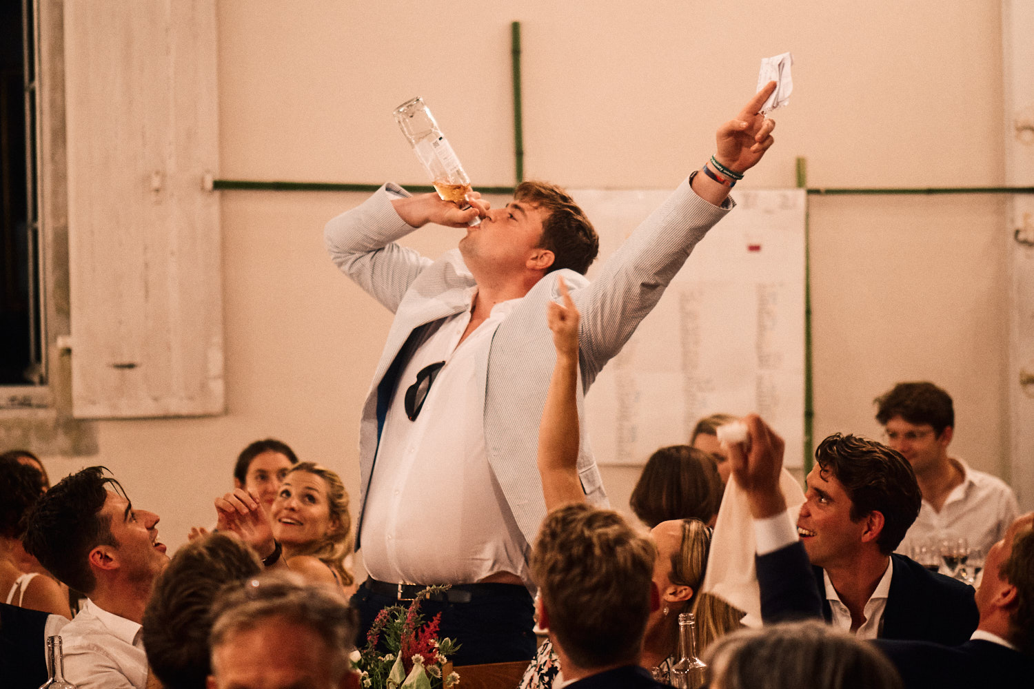 The best man celebrates the conclusion of his speech
