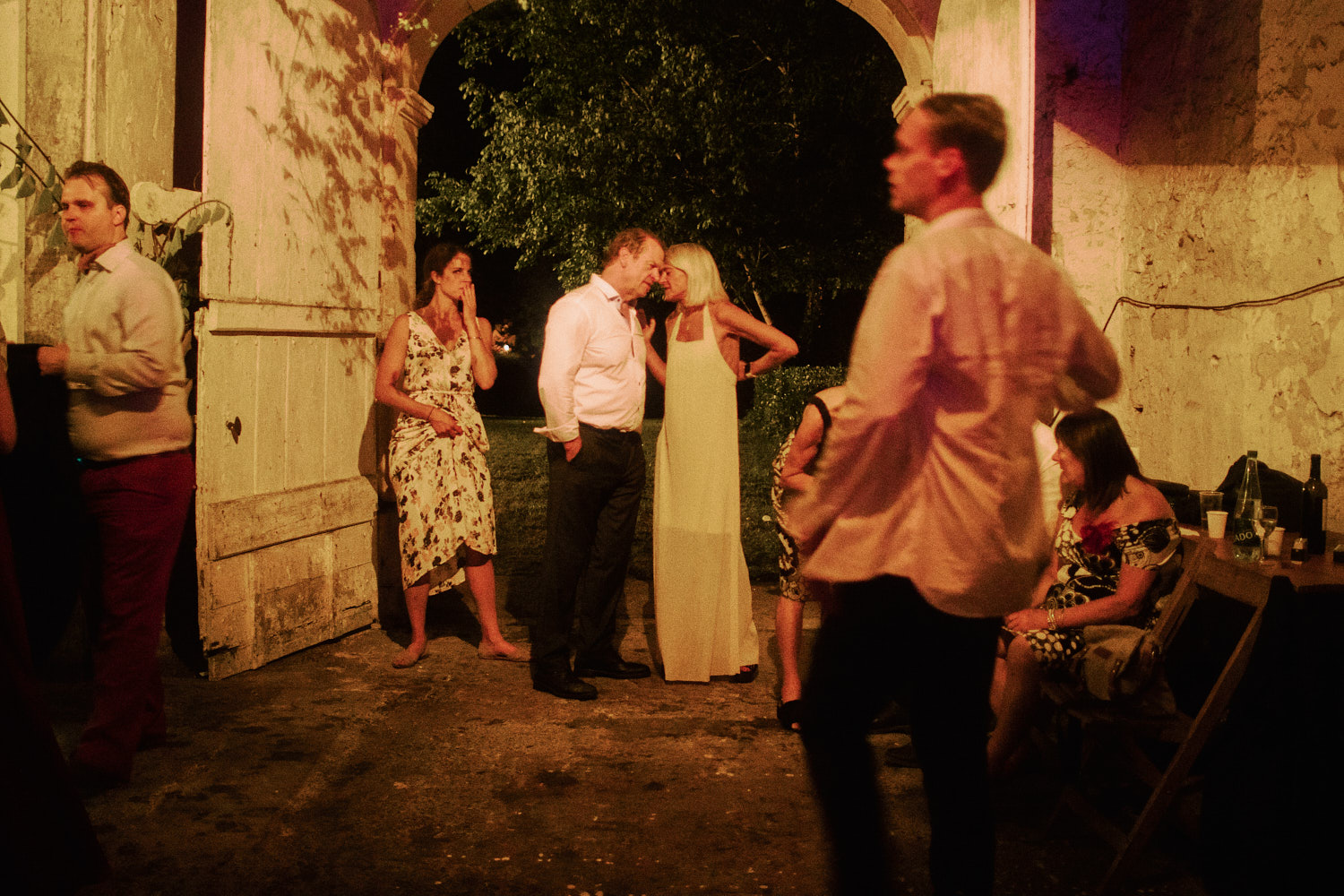 Wedding guests mingle in a barn in France