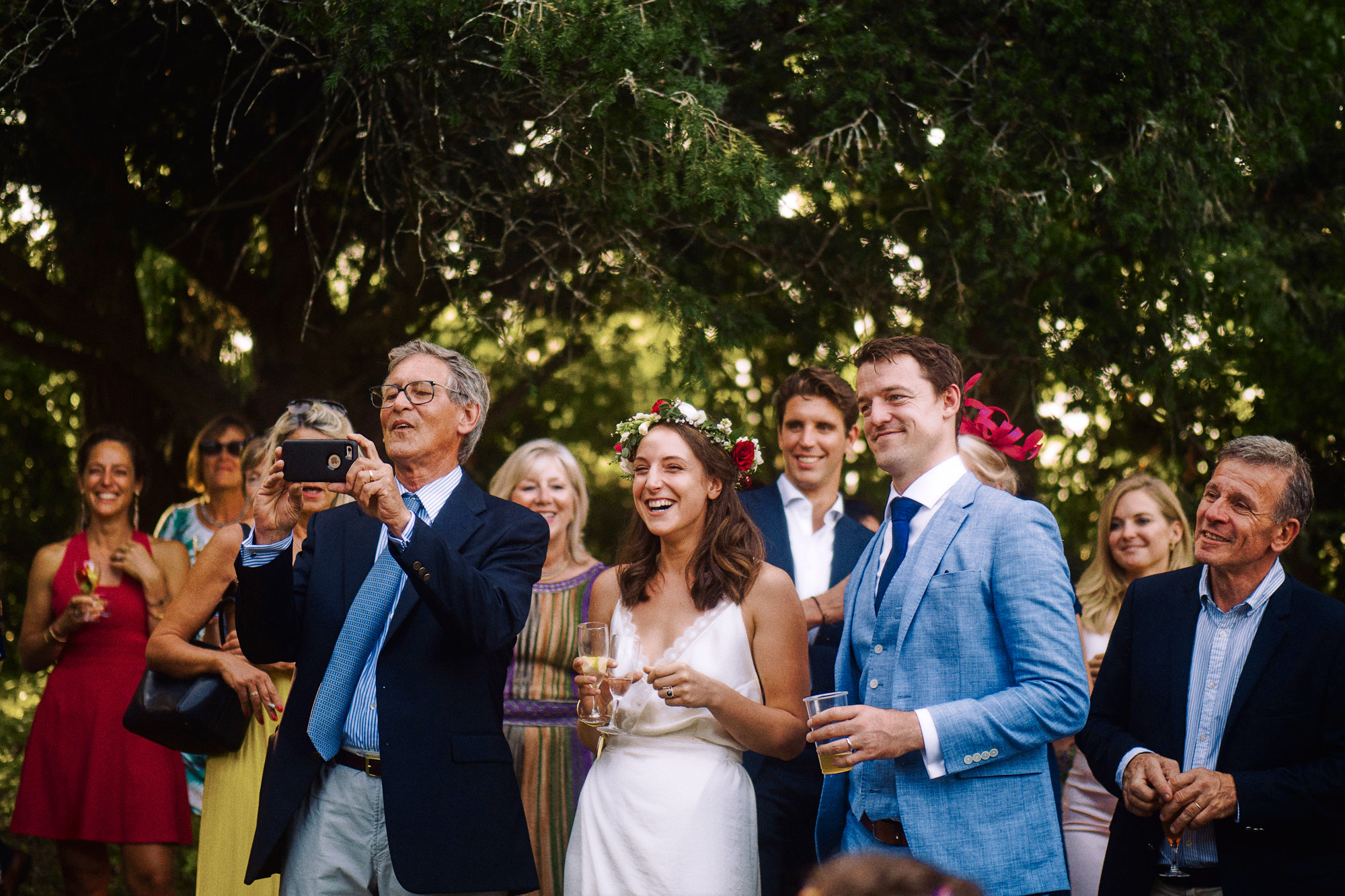French wedding couple laughing with guests